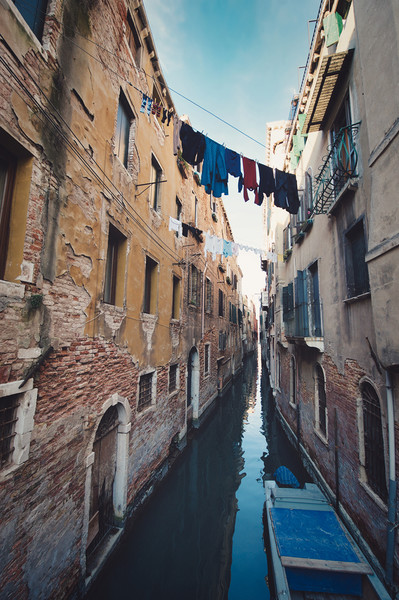 clothes hanging in the canal with gondolas, Venice Canvas Print by federico stevanin