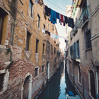 Buy canvas prints of clothes hanging in the canal with gondolas, Venice by federico stevanin