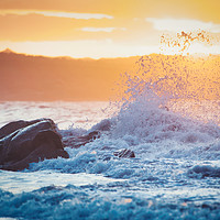 Buy canvas prints of wave breaking on the rocks at sunset by federico stevanin