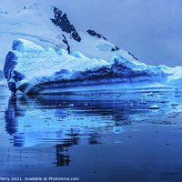 Buy canvas prints of Floating Blue Iceberg Reflection Paradise Bay Antarctica by William Perry