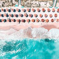 Buy canvas prints of Aerial Ocean, Blue Sea And Beach, Round Umbrellas by Radu Bercan