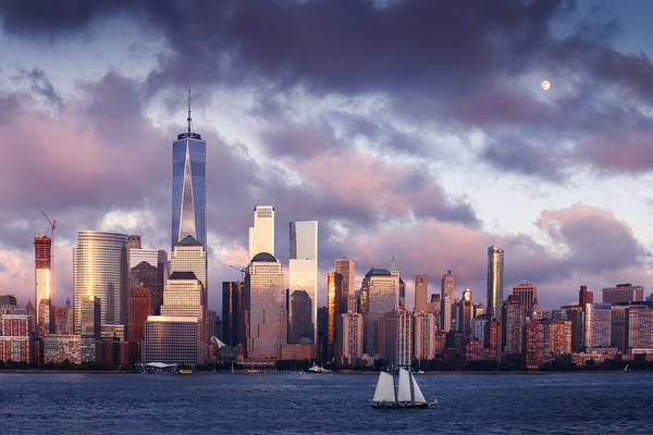 Lower Manhattan Skyline and moon rising at Blue Ho Canvas Print by Pere Sanz