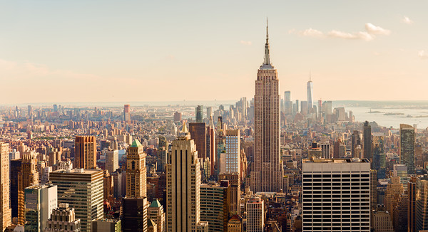 Manhattan Midtown Skyline with illuminated skyscra Framed Mounted Print by Pere Sanz