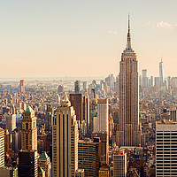Buy canvas prints of Manhattan Midtown Skyline with illuminated skyscra by Pere Sanz