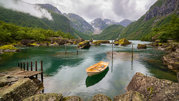 Boat in a lake close to  Buerbreen Glacier, Norway Framed Mounted Print by Pere Sanz