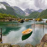 Buy canvas prints of Boat in a lake close to  Buerbreen Glacier, Norway by Pere Sanz