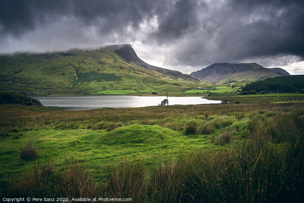 Dramatic Cloudy landscape in Snowdonia, Wales Framed Mounted Print by Pere Sanz