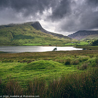 Buy canvas prints of Dramatic Cloudy landscape in Snowdonia, Wales by Pere Sanz