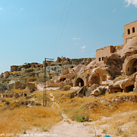 Buy canvas prints of Cappadocia cave town by Sanga Park