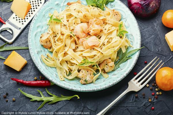 Plate of pasta with shrimps Framed Print by Mykola Lunov Mykola