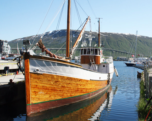 Wooden fishing boat in Tromso Print by chris hyde