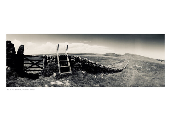 Wall and Stile near Hadrian's Wall  Framed Print by Michael Angus