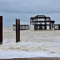 Buy canvas prints of Brighton west pier at high tide   by Julie Tattersfield