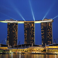 Buy canvas prints of A lit up city at night with Marina Bay Sands Singapore in the background by Alessandro Della Torre