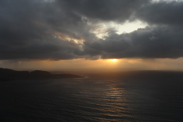 Sunset under cloudly grey clouds over northern sea ocean at north cape Framed Mounted Print by Alessandro Della Torre