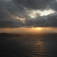 Buy canvas prints of Sunset under cloudly grey clouds over northern sea ocean at north cape by Alessandro Della Torre