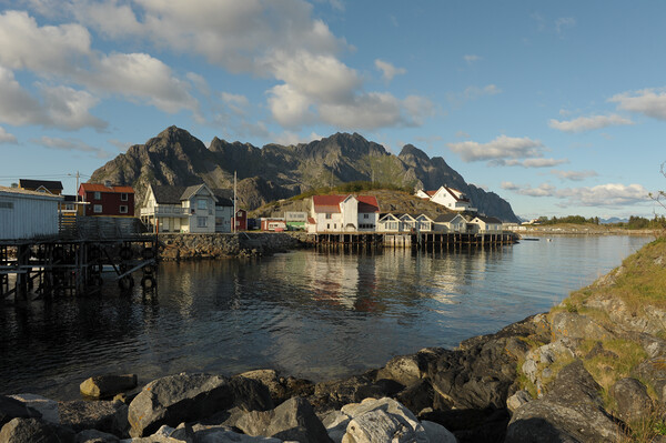 Lofoten island in front of water with a mountain in the background Framed Mounted Print by Alessandro Della Torre
