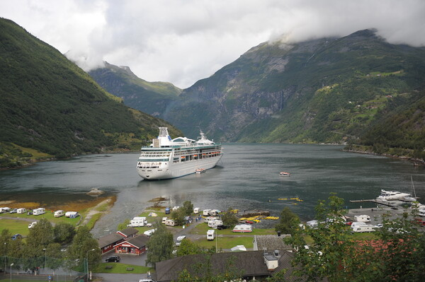 travel Cruise boat stopped into Geirangerfjord, Norway,  in the background Framed Mounted Print by Alessandro Della Torre