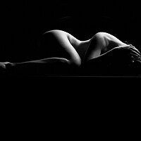 Buy canvas prints of nude bodyscape of a naked woman laying down by Alessandro Della Torre