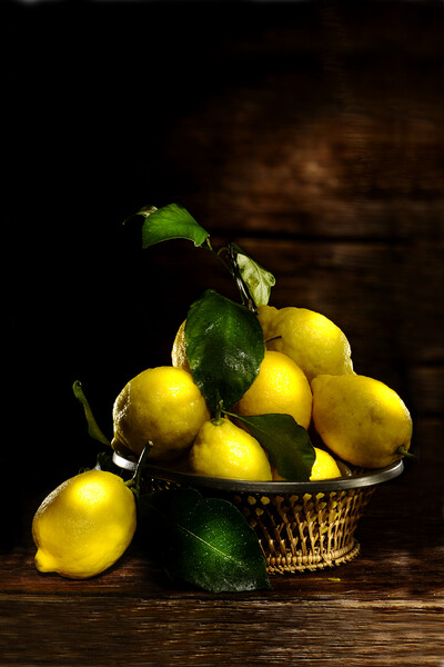 lemons on wood table Framed Mounted Print by Alessandro Della Torre