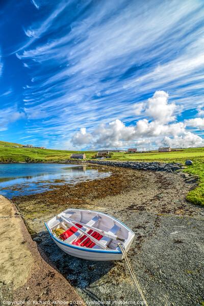 Small fishing  boat beside a Shetland Voe Framed Print by Richard Ashbee