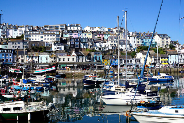 The inner harbour with reflections at Brixham in Devon. Framed Print by john hill