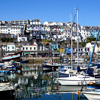 Buy canvas prints of The inner harbour with reflections at Brixham in Devon. by john hill