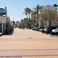 Buy canvas prints of Paseo Maritimo promenade in March at Fuengirola spain. by john hill