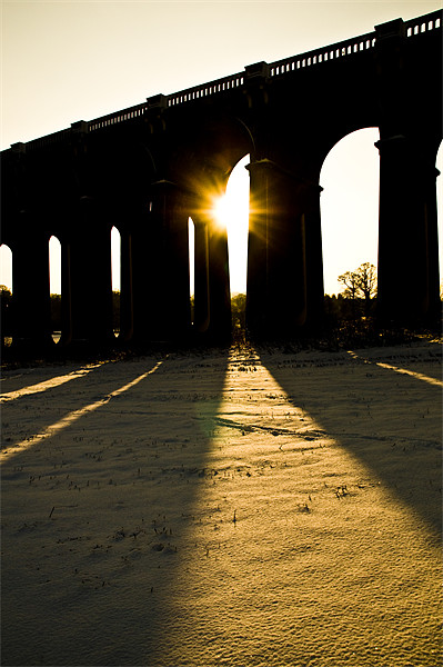 Balcombe Viaduct in the Snow at sunset Framed Print by Eddie Howland