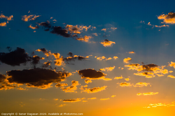 Dramatic sky at sunset Canvas Print by Sener Dagasan