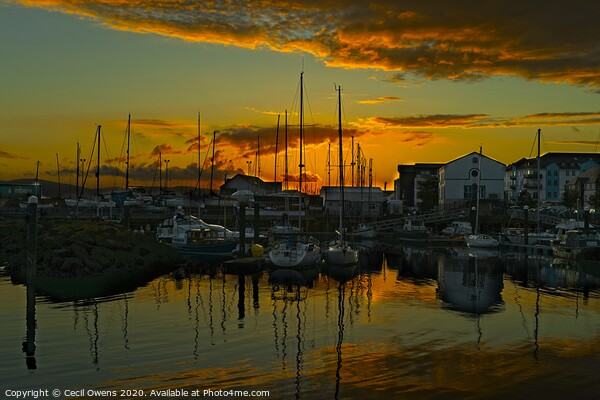 Sunset over Carrickfergus harbour. Canvas Print by Cecil Owens