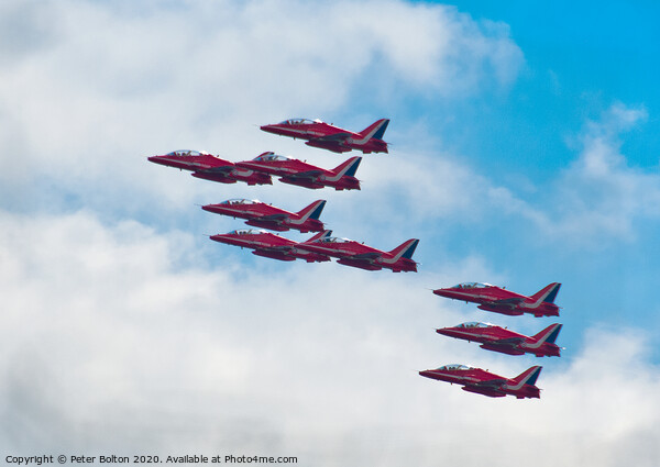 The Red Arrows in formation at a display at Southend on Sea, Essex, UK. Framed Print by Peter Bolton