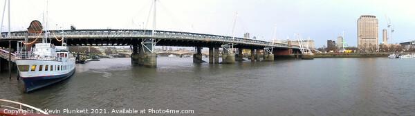 Hungerford Bridge and Golden Jubilee Bridges. River Thames Print by Kevin Plunkett