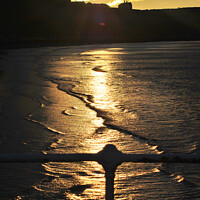 Buy canvas prints of Sunset on Whitby Beach by Fiona Williams