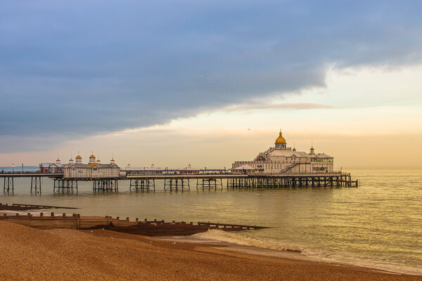 Storm clouds over Eastbourne pier Canvas Print by Andy Dow