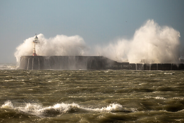 Waves breaking over Newhaven wall Canvas Print by Andy Dow