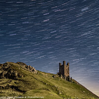 Buy canvas prints of Dunstanburgh Castle Star Trail by Robin Hunter