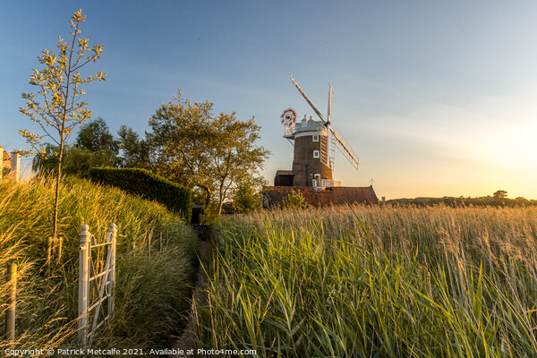 Sunset at Cley Windmill Print by Patrick Metcalfe
