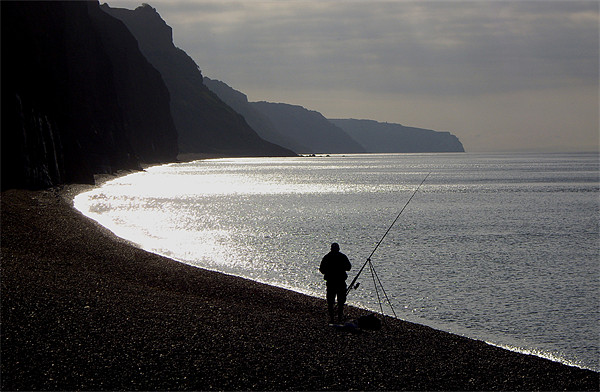 Fisherman angling on beach Canvas print by nick pautrat