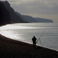 Buy canvas prints of Fisherman angling on beach by nick pautrat