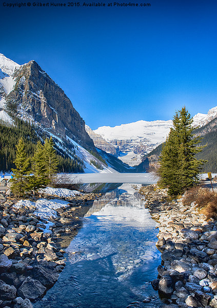 A Stream to the Frozen Lake Louise Canvas print by Gilbert Hurree