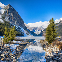 Buy canvas prints of A Stream to the Frozen Lake Louise by Gilbert Hurree
