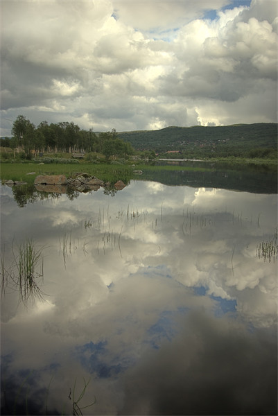 Reflecting on a lake  Framed Print by Alan Pickersgill