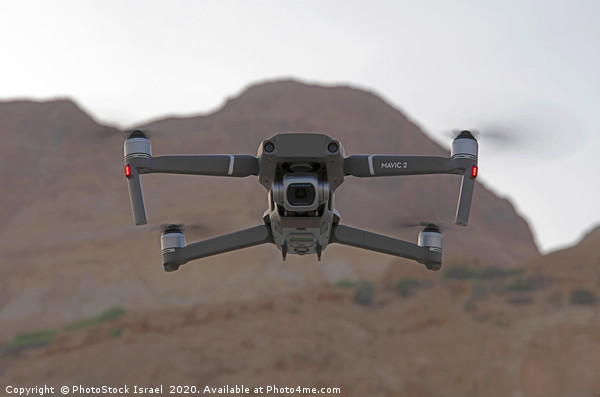 Quadrocopter, drone, with camera Canvas print by PhotoStock Israel