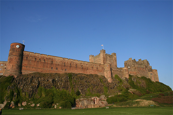 Bamburgh Castle Canvas Print by John Willsher