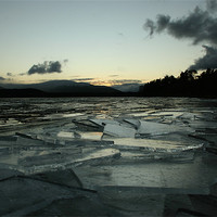 Buy canvas prints of Icy Loch Morlich by James Buckle