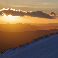 Buy canvas prints of  Mountain Sunset by James Buckle