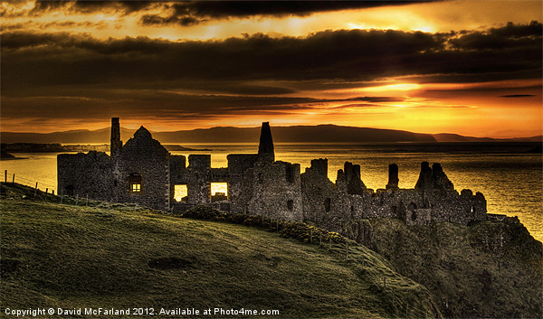 Sunset over Dunluce Castle Canvas print by David McFarland