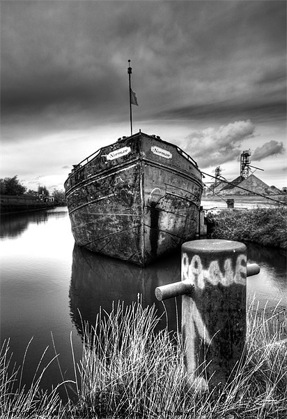 The sand barge tied up Canvas print by David McFarland