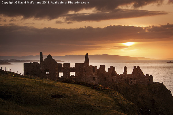 Sunset over Dunluce Castle Canvas print by David McFarland